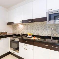 Апартаменты The Regent Phuket Serviced Apartment Kamala Beach кухня в номере фото 2