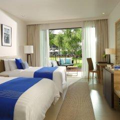 Отель Holiday Inn Resort Phuket Mai Khao Beach 4* Номер Делюкс разные типы кроватей фото 3