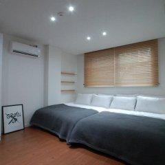 Отель YE'4 Guesthouse 2* Стандартный семейный номер с двуспальной кроватью