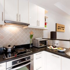 Отель Angsana Villas Resort Phuket кухня в номере