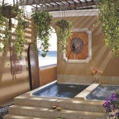 Отель The Ritz-Carlton Cancun крытая спа-ванна