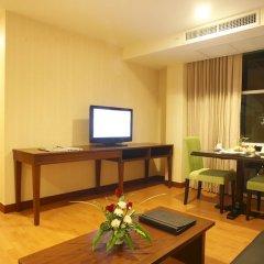 Отель The Kris Residence гостиная фото 2