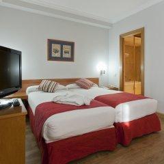 Отель Aparto Suites Muralto Апартаменты с различными типами кроватей