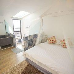 Отель Glur Bangkok Стандартный номер разные типы кроватей