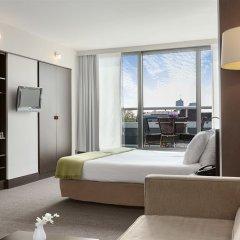 Отель NH Amsterdam Caransa 4* Улучшенный номер с различными типами кроватей