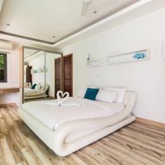 Отель Beachfront Villa 3* Вилла с различными типами кроватей