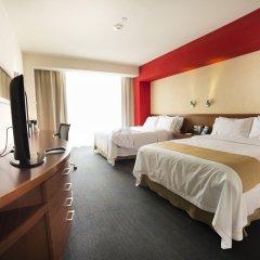 Отель Holiday Inn Express Guadalajara Expo комната для гостей