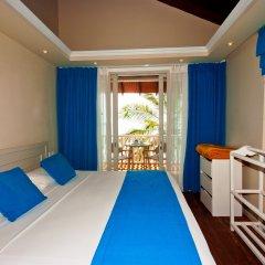 Отель Cinnamon Dhonveli Maldives-Water Suites 5* Бунгало с различными типами кроватей
