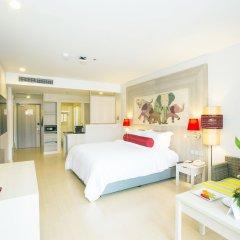 Отель Ramada by Wyndham Phuket Deevana Patong Улучшенный номер с различными типами кроватей фото 2