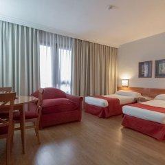 Отель Aparto Suites Muralto Улучшенные апартаменты с 2 отдельными кроватями