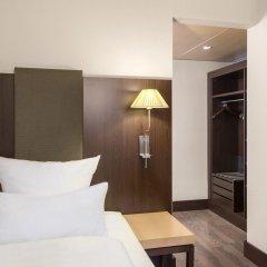 Отель NH Düsseldorf Königsallee 4* Улучшенный номер с различными типами кроватей фото 6