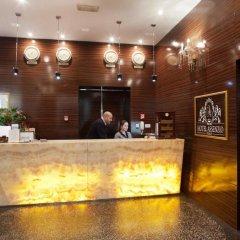 Отель Assenzio вестибюль