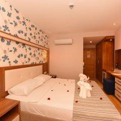 Отель Liberty Hotels Oludeniz 4* Улучшенный номер с различными типами кроватей фото 4