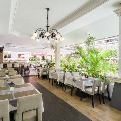 Отель Tropical Palm Resort Самуи ресторанный дворик