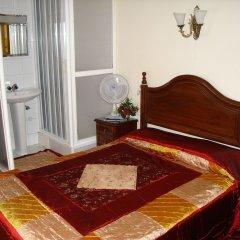 Отель Pensão Pérola da Baixa 2* Номер с различными типами кроватей (общая ванная комната)