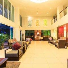 Отель The Kris Residence лобби