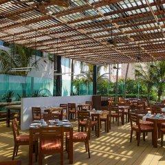 Отель Reflect Krystal Grand Cancun столовая на открытом воздухе фото 2