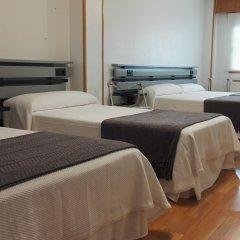 Отель Toctoc Rooms Стандартный семейный номер с двуспальной кроватью