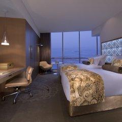 Jumeirah at Etihad Towers Hotel 5* Улучшенный номер с различными типами кроватей фото 3