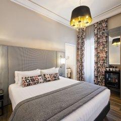 Отель The Independent Suites Представительский номер с различными типами кроватей