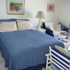 Отель Ocean Suite Beach Front at Mobay Club Студия с различными типами кроватей