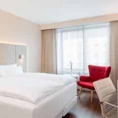 Отель NH Collection Frankfurt City 4* Улучшенный номер с различными типами кроватей