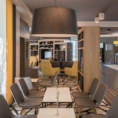 Отель Holiday Inn Munich-Unterhaching Германия, Унтерхахинг - 7 отзывов об отеле, цены и фото номеров - забронировать отель Holiday Inn Munich-Unterhaching онлайн интерьер отеля фото 2
