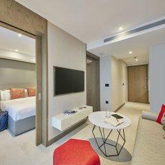 Отель Oakwood Studios Singapore 4* Апартаменты с различными типами кроватей
