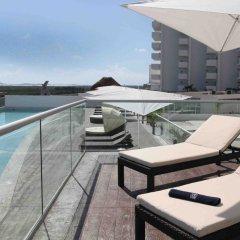 Отель Suites Malecon Cancun открытая веранда