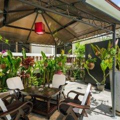 Отель Tropical Palm Resort Самуи столовая на открытом воздухе