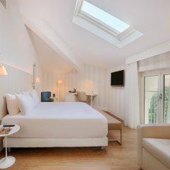 Отель NH Genova Centro 4* Стандартный семейный номер с двуспальной кроватью