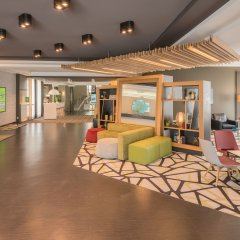 Отель Holiday Inn Munich-Unterhaching Германия, Унтерхахинг - 7 отзывов об отеле, цены и фото номеров - забронировать отель Holiday Inn Munich-Unterhaching онлайн интерьер отеля
