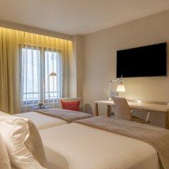 Отель NH Collection Lisboa Liberdade 4* Стандартный номер с разными типами кроватей