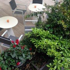 Отель Hilton Garden Inn Milan North сад