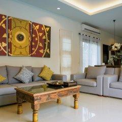Отель Two Villas Holiday Oriental Style Layan Beach гостиная фото 5