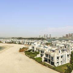 Отель Bespoke Residences - Shoreline Al Haseer пляж