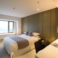Отель Sheraton Grande Walkerhill Номер Делюкс с различными типами кроватей