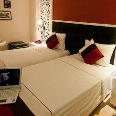 Oriental Central Hotel 3* Улучшенный номер с 2 отдельными кроватями фото 2