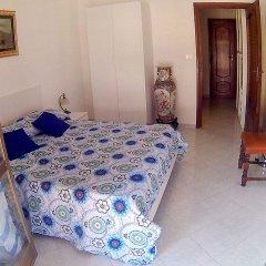 Отель Atticvs di Mamma Ines Стандартный номер с двуспальной кроватью (общая ванная комната)