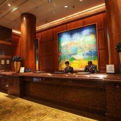 Отель Conrad Centennial Singapore ресепшен фото 2