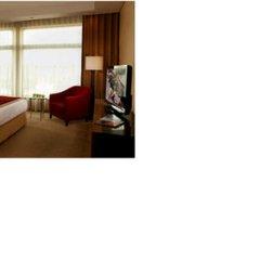 Отель Swissotel Al Ghurair Dubai Дубай сейф в номере
