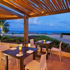 Отель Reflect Krystal Grand Cancun столовая на открытом воздухе