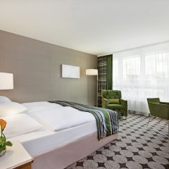 Moevenpick Hotel Nuernberg Airport комната для гостей фото 4