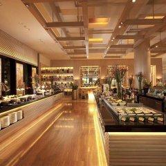 Отель Conrad Centennial Singapore гостиничный бар фото 2