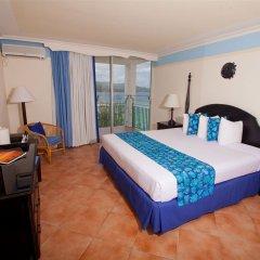 Отель Sunset Beach Resort Spa and Waterpark All Inclusive Ямайка, Монтего-Бей - отзывы, цены и фото номеров - забронировать отель Sunset Beach Resort Spa and Waterpark All Inclusive онлайн комната для гостей фото 4