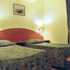 Гостиница Достоевский комната для гостей фото 3
