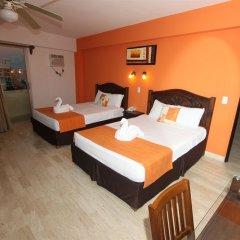 Отель Calypso Hotel Cancun Мексика, Канкун - отзывы, цены и фото номеров - забронировать отель Calypso Hotel Cancun онлайн вход в здание