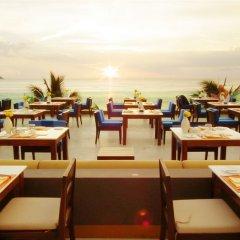 Отель La Flora Resort Patong столовая на открытом воздухе