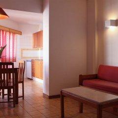 Отель Clube Praia Da Rocha Apartmentos Португалия, Портимао - отзывы, цены и фото номеров - забронировать отель Clube Praia Da Rocha Apartmentos онлайн комната для гостей фото 3