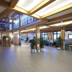 Отель Top Commundo Tagungshotel Ismaning Исманинг интерьер отеля фото 3